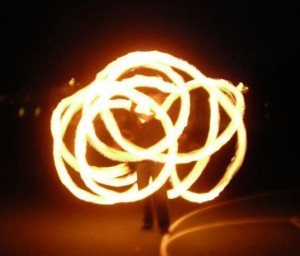 Me spinning fire poi at one of our club meetings